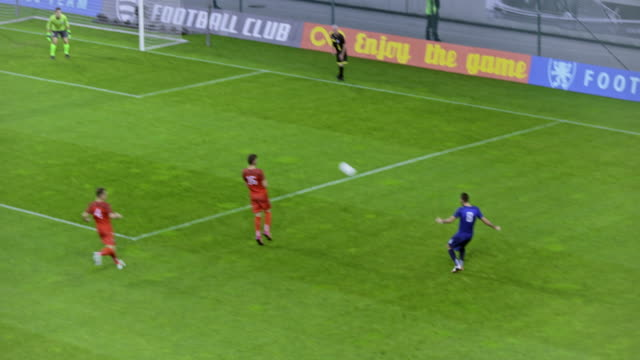 soccer players passing the ball and missing a goal - trikot stock-videos und b-roll-filmmaterial