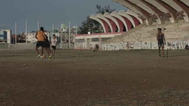 Soccer players playing on field in Havana, Cuba