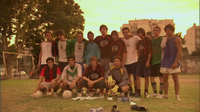 ms, pan, soccer players posing for team photo on  field, buenos aires, argentina - チーム写真点の映像素材/bロール