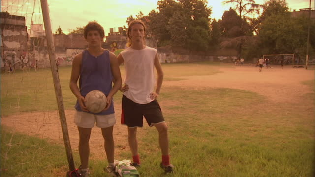 MS, soccer players posing on field, Buenos Aires, Argentina