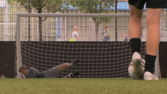 ms la soccer players taking practice shots, london, uk - ゴールポスト点の映像素材/bロール