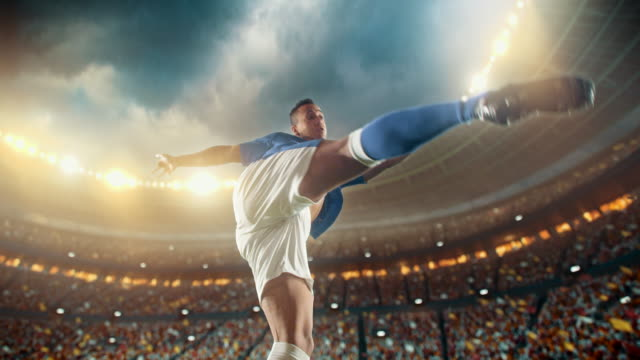 soccer: professional player makes a strong kick - kicking stock videos & royalty-free footage