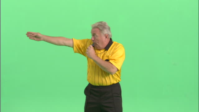 ms, soccer referee blowing whistle and gesturing in studio, portrait - football strip stock videos & royalty-free footage