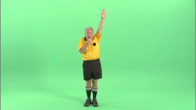 vídeos de stock, filmes e b-roll de ws, soccer referee blowing whistle and signaling indirect free kick / studio, portrait - árbitro