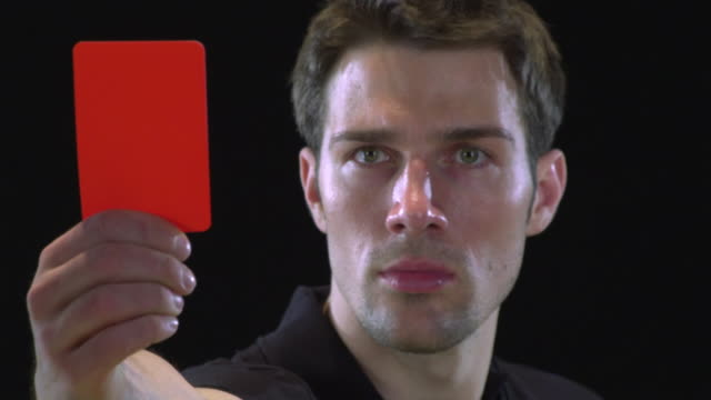 CU Soccer referee holding red card / Berlin, Germany