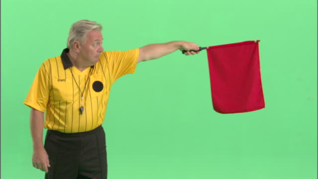 ms, soccer referee pointing with red flag in studio - neenah stock videos & royalty-free footage