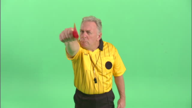 ms, soccer referee showing red card in studio, portrait - neenah stock videos & royalty-free footage