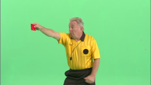 MS, Soccer referee showing red card in studio