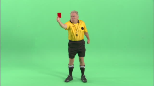 ws, soccer referee showing red card in studio - neenah stock videos & royalty-free footage