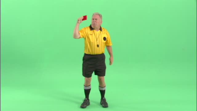 ws, soccer referee showing yellow and red cards in studio - football strip stock videos & royalty-free footage