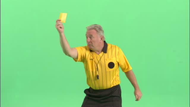 ms, soccer referee showing yellow card in studio - neenah stock videos & royalty-free footage