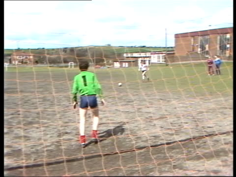 england manchester ms mark robins practising with football cms robins' feet kicks ball ms robins kicking ball into goal net ms gordon robins father... - 20 29 years stock videos & royalty-free footage
