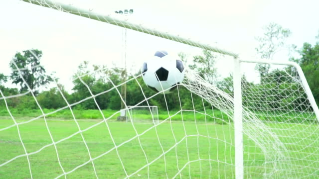 soccer slow motion concept of the ball flying into goal ne - international team soccer stock videos & royalty-free footage