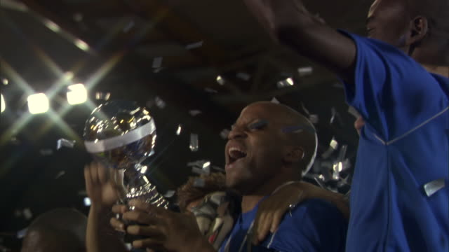 stockvideo's en b-roll-footage met la pan cu soccer team jumping and celebrating with trophy as confetti falls / sheffield, england, uk - championship
