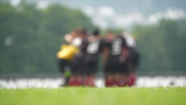 soccer team playing on soccer field. sports competition concept background - soccer competition stock videos & royalty-free footage