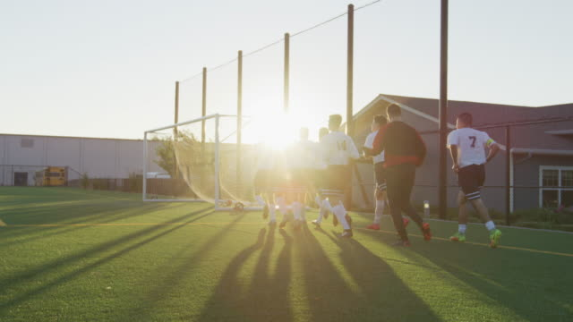 soccer team running around the field before a game - football team stock videos & royalty-free footage