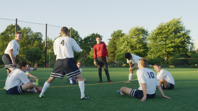 soccer team stretching before a game - football team stock videos & royalty-free footage