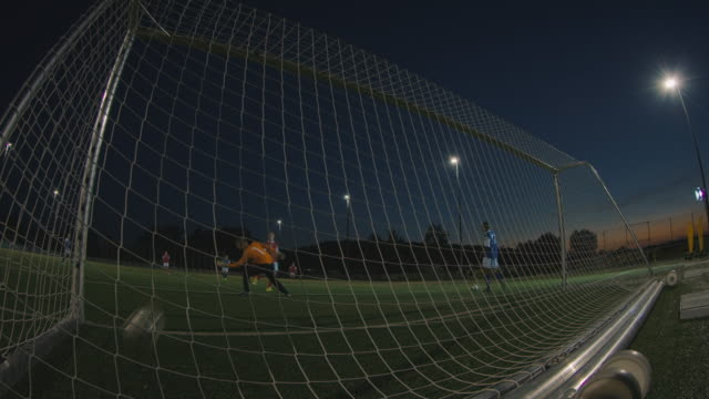 soccer training on playing field at night - shooting at goal stock videos & royalty-free footage