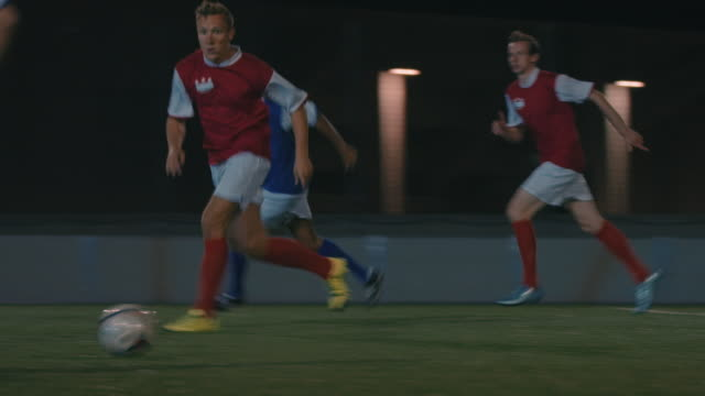 soccer training on playing field at night - soccer player stock videos and b-roll footage
