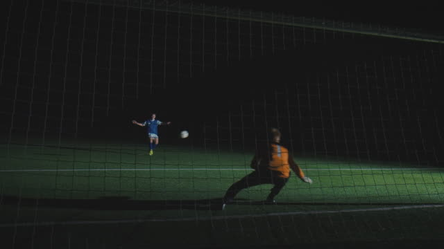 soccer training on playing field at night - kicking stock videos and b-roll footage