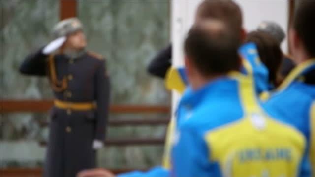 sochi 2014 winter paralympics: ukrainian team threatens boycott; russia: sochi: ext **music heard sot** vladimir putin shaking hands with russian... - sleeve stock videos & royalty-free footage