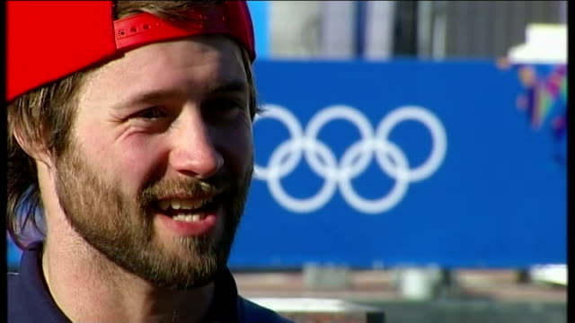 preparations for the games billy morgan interview sot backview men wearing 'sochi 2014' anoraks woman along wearing headband with russian flags... - hair accessory stock videos & royalty-free footage