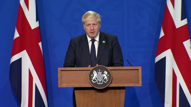 boris johnson, rishi sunak and sajid javid press conference; press conference part 5 of 13 england: london: westminster: downing street briefing... - bbc点の映像素材/bロール