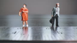 Social distancing concept with Miniature people,Dolly macro shot.