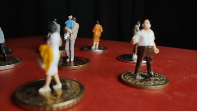social distancing concept with miniature people,rotate macro shot. - social issues stock videos & royalty-free footage