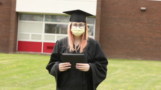social distancing graduate outdoors with diploma - diploma stock videos & royalty-free footage