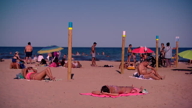social distancing markers on alicante beach as spain reopens its tourism sector after coronavirus lockdown - tourism stock videos & royalty-free footage