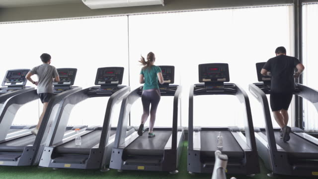 social distancing - running on treadmill in gym - exercise machine stock videos & royalty-free footage