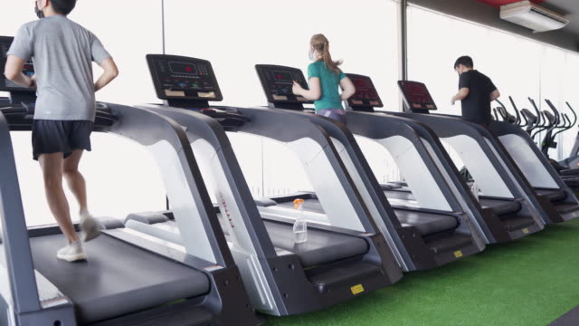 social distancing - running on treadmill in gym - health club stock videos & royalty-free footage