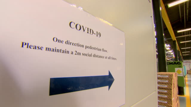 social distancing sign and one way system put in place in factory in northern ireland so people can return to work safely after coronavirus lockdown - place of work stock videos & royalty-free footage