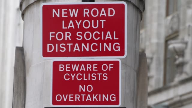 a social distancing sign is in place telling motorist that a new road layout is now in place in the city of london on august 02 2020 in london england - central london stock videos & royalty-free footage