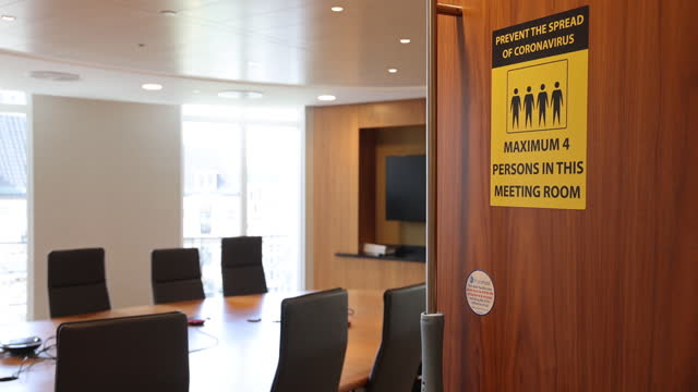 social distancing sign on a meeting room door in the offices of n+1 singer ltd., during a tour showcasing coronavirus safety measures in the city of... - board room stock videos & royalty-free footage
