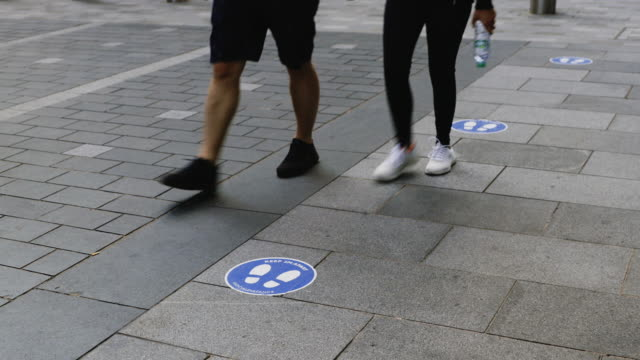 social distancing signs and notices in urban streets - sign stock videos & royalty-free footage