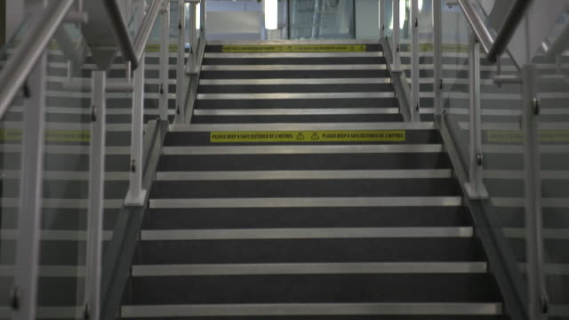 social distancing signs on staircase in school as schools prepare to reopen after coronavirus lockdown - staircase stock videos & royalty-free footage