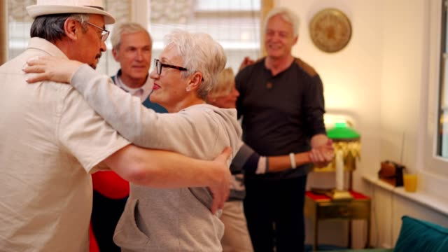 social gathering of senior friends - community centre stock videos & royalty-free footage