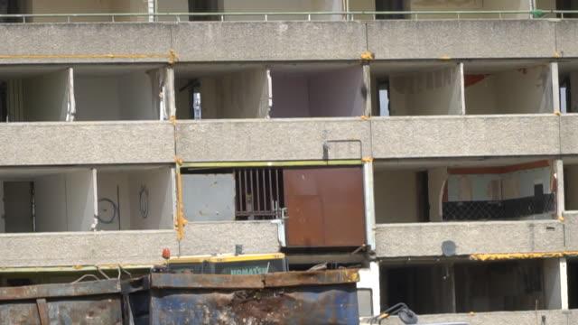 a social housing block being demolished - baufahrzeug stock-videos und b-roll-filmmaterial