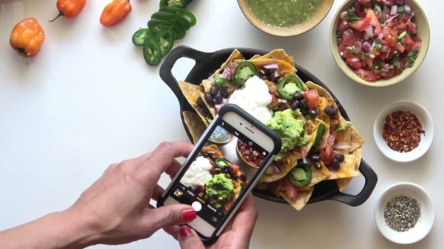 social media food photography. nachos. - photography themes stock videos & royalty-free footage