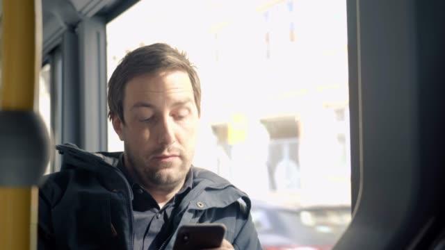 social media on the go - bus stock-videos und b-roll-filmmaterial