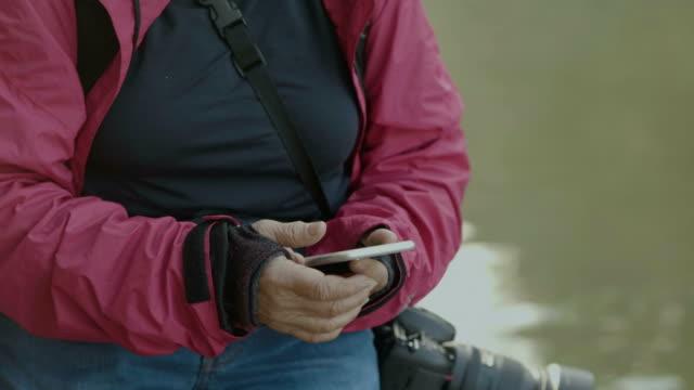 social media : senior women using phone - active seniors stock videos & royalty-free footage