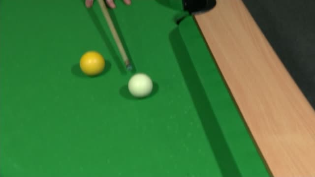 Social mobility in Stoke INT GVs Local MP Tristram Hunt playing snooker with young people at YMCA Centre Tristram and ITN Reporter listening to local...
