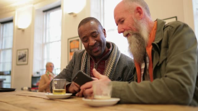 social seniors in a cafe - male friendship stock videos & royalty-free footage
