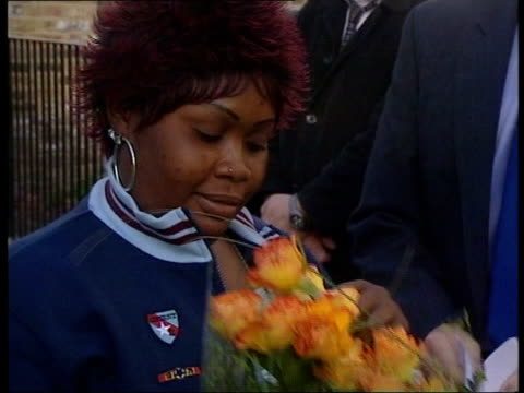 Social services blamed for death of ToniAnne Byfield LIB London EXT Roselyn Richards mother of murdered schoolgirl ToniAnn Byfield laying flowers...