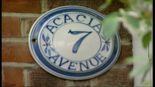 social study on acacia avenue residents; close-up bee on lavender flower house number 7 sign jean brown interview sot - on never moving - number 7 stock videos & royalty-free footage