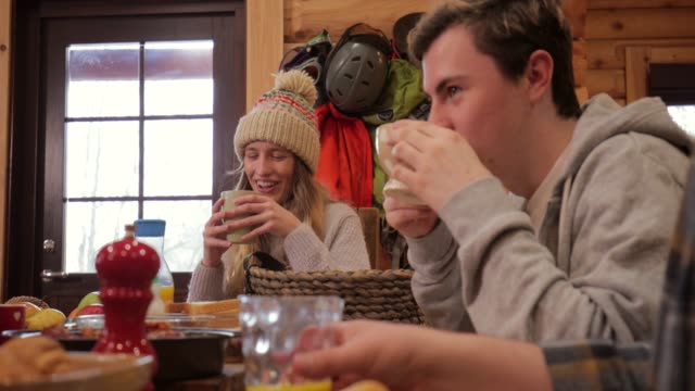 socialising over breakfast before skiing - stazione sciistica video stock e b–roll