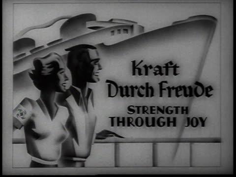vídeos de stock, filmes e b-roll de socialism sign for strength through joy kraft durch freude / new york usa - figura feminina