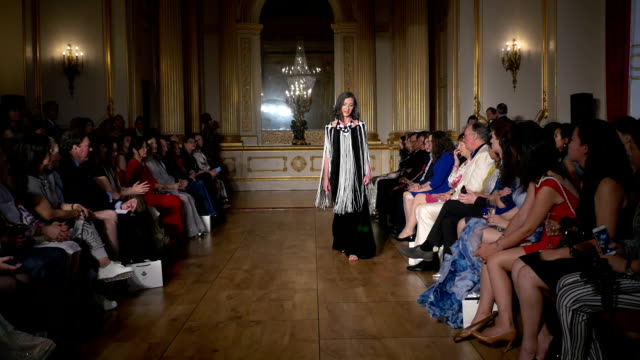 Socialite Nicola Coates on Grace Chen fashion catwalk show at Lancaster House London on June 11 2016